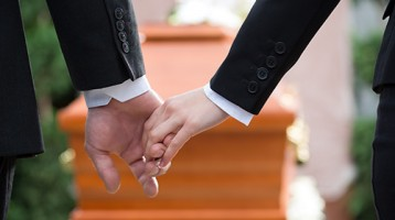 Holding hands coffin